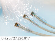 Купить «Closeup of RJ45 UTP LAN on the background of optical fibers with blurred lights», фото № 27290817, снято 19 декабря 2018 г. (c) Mikhail Starodubov / Фотобанк Лори