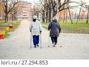 Older women walk around the park with ski poles. Life is retired. Стоковое фото, фотограф Леонид Еремейчук / Фотобанк Лори