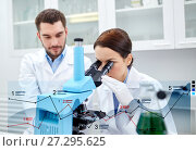 Купить «scientists with microscope making research in lab», фото № 27295625, снято 4 декабря 2014 г. (c) Syda Productions / Фотобанк Лори
