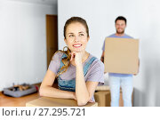 Купить «happy couple with boxes moving to new home», фото № 27295721, снято 4 июня 2017 г. (c) Syda Productions / Фотобанк Лори