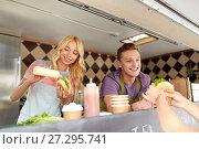 Купить «happy sellers serving customers at food truck», фото № 27295741, снято 1 августа 2017 г. (c) Syda Productions / Фотобанк Лори