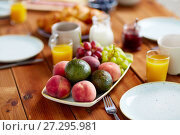 Купить «fruits, juice and other food on table at breakfast», фото № 27295981, снято 5 октября 2017 г. (c) Syda Productions / Фотобанк Лори