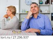 Купить «Mature couple decide family matters and find out relationship», фото № 27296937, снято 18 января 2019 г. (c) Яков Филимонов / Фотобанк Лори