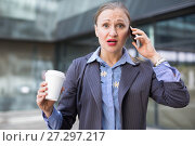 Купить «Adult businesswoman talking on the mobile phone», фото № 27297217, снято 6 мая 2017 г. (c) Яков Филимонов / Фотобанк Лори