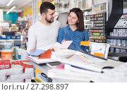 Купить «Couple examining various decorative materials», фото № 27298897, снято 9 марта 2017 г. (c) Яков Филимонов / Фотобанк Лори