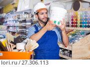 Купить «Cheerful workman choosing materials», фото № 27306113, снято 13 сентября 2017 г. (c) Яков Филимонов / Фотобанк Лори