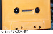 Купить «vintage orange audio cassette tape with a blank label», видеоролик № 27307481, снято 12 апреля 2017 г. (c) Курганов Александр / Фотобанк Лори