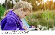 Купить «Young beautiful girl reading e-book», видеоролик № 27307541, снято 24 августа 2017 г. (c) BestPhotoStudio / Фотобанк Лори