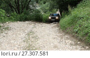 Rostov on Don, Russian Federation - June 13, 2014: SUV drives into the mountain to impassable mud. Редакционное видео, видеограф Курганов Александр / Фотобанк Лори
