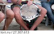 Купить «Unidentified man playing on drum», видеоролик № 27307613, снято 18 апреля 2017 г. (c) Курганов Александр / Фотобанк Лори