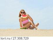 Купить «Young female eating watermelon on the beach», фото № 27308729, снято 21 июля 2010 г. (c) Курганов Александр / Фотобанк Лори