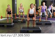 Купить «Group of young females training with barbell workout», фото № 27309593, снято 26 июля 2017 г. (c) Яков Филимонов / Фотобанк Лори