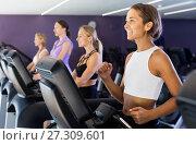 Купить «Slender athletic girls running on treadmill in fitness club», фото № 27309601, снято 26 июля 2017 г. (c) Яков Филимонов / Фотобанк Лори