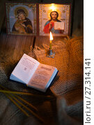 Купить «andle against the background of orthodox icons», фото № 27314141, снято 22 декабря 2017 г. (c) Типляшина Евгения / Фотобанк Лори