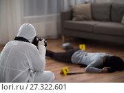 Купить «criminalist photographing dead body at crime scene», фото № 27322601, снято 5 мая 2017 г. (c) Syda Productions / Фотобанк Лори
