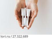 Купить «hand holding tubes of micro enema», фото № 27322689, снято 27 сентября 2017 г. (c) Syda Productions / Фотобанк Лори
