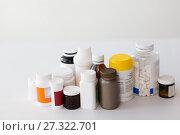 Купить «jars of different medicines», фото № 27322701, снято 27 сентября 2017 г. (c) Syda Productions / Фотобанк Лори