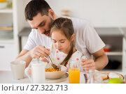 Купить «happy family eating flakes for breakfast at home», фото № 27322713, снято 19 октября 2017 г. (c) Syda Productions / Фотобанк Лори