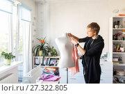 Купить «fashion designer with dummy making dress at studio», фото № 27322805, снято 28 июня 2017 г. (c) Syda Productions / Фотобанк Лори