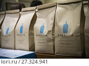 Купить «Bags of coffee beans in a busy Blue Bottle Coffee shop in New York on Friday, September 15, 2017. Nestlé acquired a 68 stake in Blue Bottle Coffee in a...», фото № 27324941, снято 15 сентября 2017 г. (c) age Fotostock / Фотобанк Лори