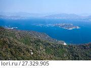 Купить «Вид на гряду Shikoku Mountain Ranges островки в море Seto Inland Sea. Площадка на горе Mt. Misen. Остров Itsukusima, Япония», фото № 27329905, снято 13 апреля 2013 г. (c) Кекяляйнен Андрей / Фотобанк Лори