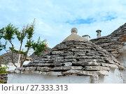 Купить «Trulli houses roofs in Alberobello, Italy», фото № 27333313, снято 6 июня 2017 г. (c) Юрий Брыкайло / Фотобанк Лори
