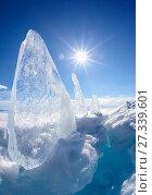 Купить «Ice floe and sun on winter Baikal lake», фото № 27339601, снято 16 марта 2013 г. (c) Serg Zastavkin / Фотобанк Лори