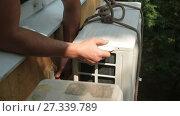 Купить «Installing of Air Conditioner», видеоролик № 27339789, снято 27 августа 2016 г. (c) Илья Шаматура / Фотобанк Лори