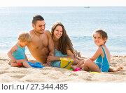 Купить «Family of four at the beach», фото № 27344485, снято 25 июня 2014 г. (c) Яков Филимонов / Фотобанк Лори