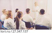 Купить «Professor giving presentation for medical students», фото № 27347137, снято 5 октября 2017 г. (c) Яков Филимонов / Фотобанк Лори