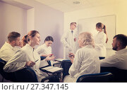 Купить «Young students of medical faculty talking with teacher», фото № 27347145, снято 5 октября 2017 г. (c) Яков Филимонов / Фотобанк Лори