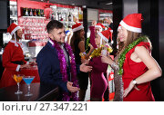 Купить «Man with females on corporate new year party in bar», фото № 27347221, снято 29 ноября 2017 г. (c) Яков Филимонов / Фотобанк Лори