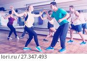 Купить «People learning swing at dance class», фото № 27347493, снято 24 октября 2018 г. (c) Яков Филимонов / Фотобанк Лори