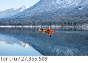 Two people kayaking in the winter among mountains. Стоковое фото, фотограф Anton Chechotkin / Фотобанк Лори