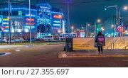 Купить «Вход на станцию метро Митино вечером», эксклюзивное фото № 27355697, снято 4 января 2018 г. (c) Виктор Тараканов / Фотобанк Лори