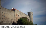 Купить «National flag of Estonia on blue sky move over Long Herman - a tower of Toompea Castle on the hill Toompea. Tallinn, Estonia», видеоролик № 27356073, снято 10 ноября 2009 г. (c) Куликов Константин / Фотобанк Лори