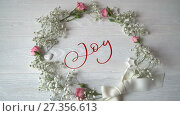 Купить «Joy Vintage Written animation word on round wreath with branch on white wooden background. Calligraphy and lettering flourish elements for Valentines Day wedding or other holidays», видеоролик № 27356613, снято 6 января 2018 г. (c) Happy Letters / Фотобанк Лори