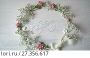 Купить «Joy Vintage Written animation word on round wreath with branch on white wooden background. Calligraphy and lettering flourish elements for Valentines Day wedding or other holidays», видеоролик № 27356617, снято 6 января 2018 г. (c) Happy Letters / Фотобанк Лори