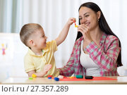 Купить «Family mother and kid boy molded from clay and play together at home. Concept of preschool or home education.», фото № 27357289, снято 12 июля 2020 г. (c) Оксана Кузьмина / Фотобанк Лори