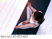 Купить «Relaxed young woman in yoga meditation pose indoor», фото № 27357437, снято 12 марта 2017 г. (c) Pavel Biryukov / Фотобанк Лори