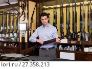 Adult male owner of hunting shop standing with shotgun. Стоковое фото, фотограф Яков Филимонов / Фотобанк Лори