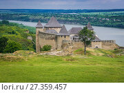 Купить «Khotyn Fortress, located on the bank of Dnister River in Chernivtsi Oblast of western Ukraine. Mosque ruins on foreground.», фото № 27359457, снято 13 июня 2017 г. (c) easy Fotostock / Фотобанк Лори