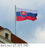 Купить «National flag of slovakia waving against blue sky at roof», фото № 27371141, снято 3 ноября 2017 г. (c) Яков Филимонов / Фотобанк Лори