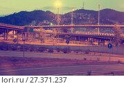 Купить «View of city highway in dusk with trace of blurred headlights», фото № 27371237, снято 20 июля 2017 г. (c) Яков Филимонов / Фотобанк Лори