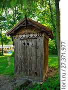 Купить «Museum of Agriculture in Ciechanowiec, Podlaskie voivodeship, Poland. Wooden cottages, garden, mill, church and other devices used to use by Pollish farmers.», фото № 27371977, снято 19 марта 2019 г. (c) age Fotostock / Фотобанк Лори