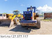 Купить «Front loader at construction site», фото № 27377117, снято 20 мая 2016 г. (c) Евгений Ткачёв / Фотобанк Лори