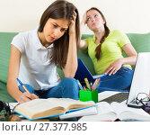 Sad students studying at home. Стоковое фото, фотограф Яков Филимонов / Фотобанк Лори