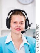 Купить «Female employee having a productive day at call-centre», фото № 27377997, снято 9 июня 2017 г. (c) Яков Филимонов / Фотобанк Лори