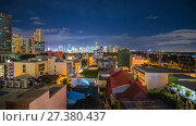 Купить «Time lapse view of Makati skyscrapers in Manila city. Skyline at night, Philippines.», видеоролик № 27380437, снято 9 января 2018 г. (c) Mikhail Davidovich / Фотобанк Лори