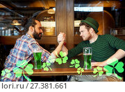 Купить «men drinking green beer and arm wrestling at pub», фото № 27381661, снято 22 апреля 2015 г. (c) Syda Productions / Фотобанк Лори